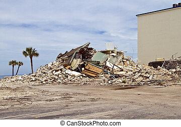 Pile of debris on the ocean shore after house demolition