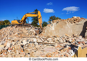 house demolition - a house is being demolished. excavators...