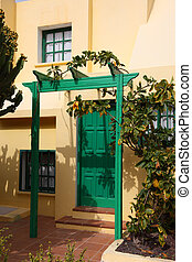 House entrance with green door