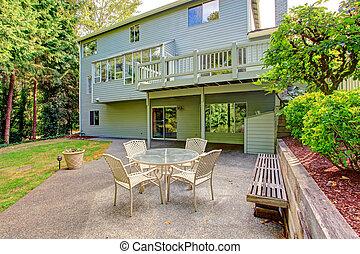 House exterior. Backyard with patio area