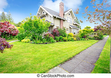 House exterior. Beautiful curb appeal - House with tropical...