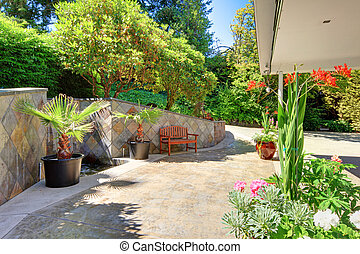 House exterior Front yard with flowers and ceramic tiles