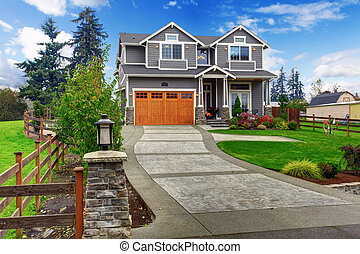 House exterior. Big house with column porch, garage and driveway view