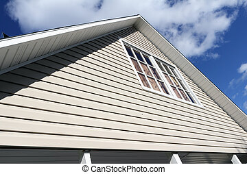 House exterior, roof close-up. Low angle view. - House...