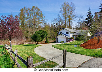 House exterior. View of driveway and front yard - House...