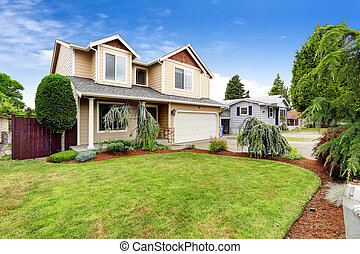 House exterior with beautiful curb appeal. Green lawn with ...