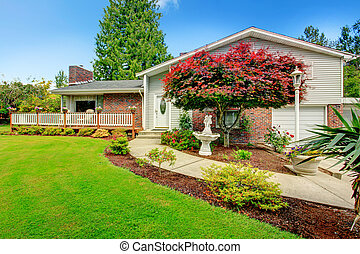 House exterior with brick wall trim