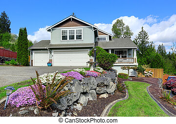 House exterior with curb appeal. View of porch and garage -...