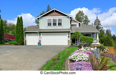 House exterior with curb appeal. View of garage and driveway...