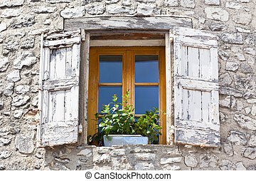 House facade with white shutters in France