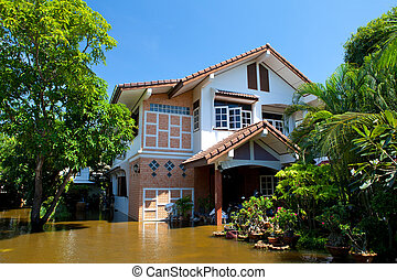 house flood in Thailand - flood waters overtake house in ...