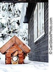 house for birds in winter landscape