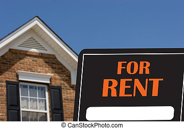 House For Rent - A black and orange for rent sign with a...