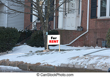 For rent sign outside in a yard