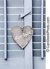 House For Sale sign on window