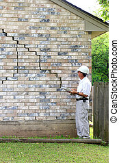 House Foundation Damage - Inspector inspecting home's ...