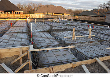 House Foundation Rebar - Trenches and rebar prep work for a...