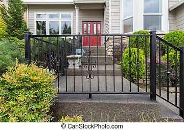 House Front Entrance with Wrought Iron Railings