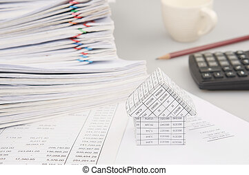 House have blur calculator and pencil with cup of coffee
