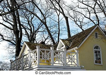 House home balcony - Yellow house with white balcony...