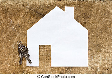 House icon and keys on dirty canvas