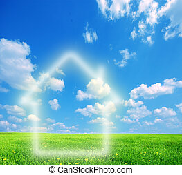 House imagination on green land. Conceptual image
