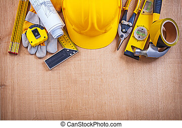 House improvement tools on oak wooden board construction concept