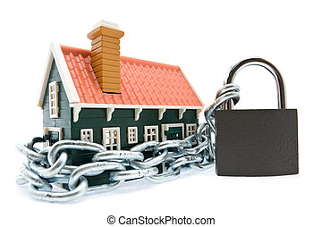 House in chains locked with padlock on white background