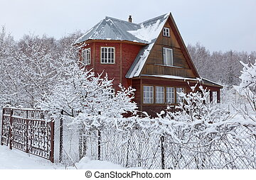 House in countryside after heavy snowfall. Moscow region. Russia.