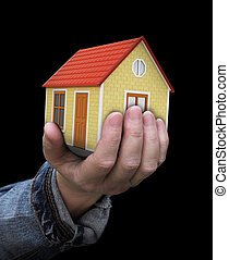 House in hand. Image with clipping path