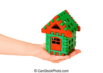 House in hand isolated on the white