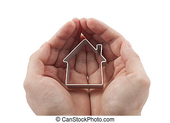 House in hands isolated on white