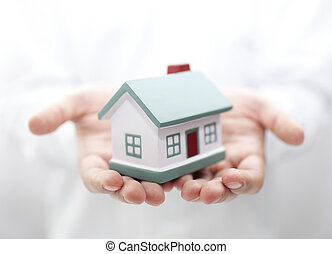 House in hands. Shallow DOF