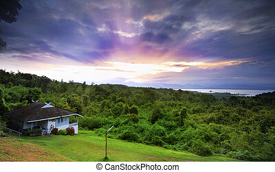 House in hill with sunrise