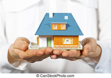 house in human hands, concept of new real estate