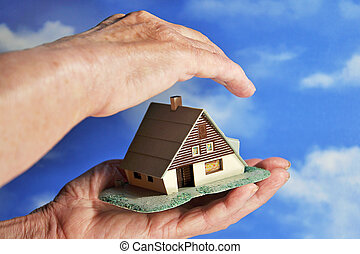 house in the hands of an elderly woman