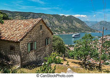 House in the mountains and view on Kotor bay from Lovcen Mountain. Montenegro.