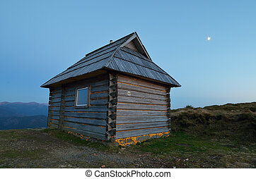 Night landscape with a lonely house in the mountains