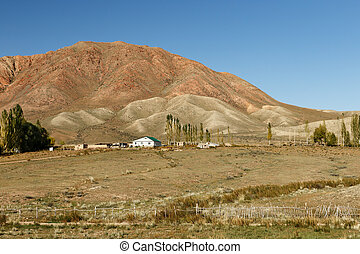 house in the mountains of Kyrgyzstan on the southern shore of Lake Issyk-Kul.