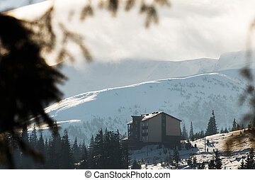 house in the winter mountains