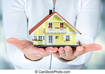 house in woman hands - real estate