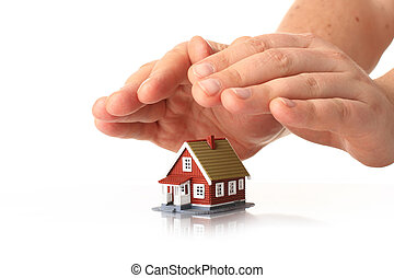 House insurance. Hands and small house over white.
