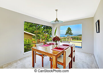Bright room with dining table set and beautiful window view