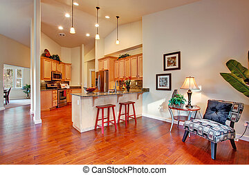 House interior with high ceiling. Kitchen area