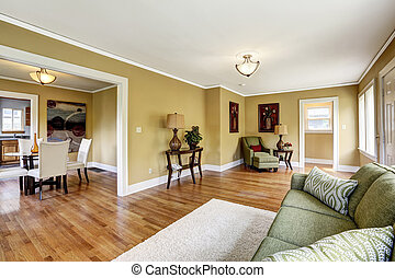 House interior with open floor plan. Living room with dining are
