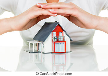 house is protected - a woman protects your house and home. ...