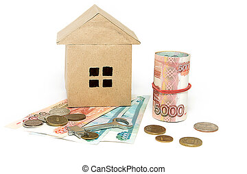House, key and money on a light background