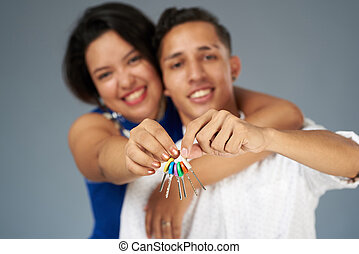 House key in couple hands