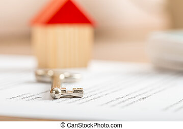 House key lying on a contract