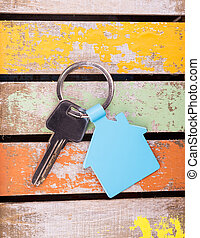 house key on wooden background